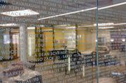 The glass wall on the second floor includes the names of $200 donors.