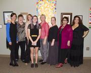 A group of featured artists at Capital Public Radio's art exhibits poses at a reception. They include: Jennifer Halm, Joey Jones, Amy Johnson, Erin Wehrli, Eileen Hook, Sarah Troedson, Sylvia Drown and Sarita Ochoa.