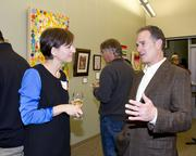 Artist Jennifer Halm and Sacramento Housing and Redevelopment Agency attorney and counsel David Levin talk at a reception for an art exhibition at Capital Public Radio.