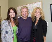 Capital Public Radio Insight host Beth Ruyak poses with Dale Carnegie Training Sacramento owner Rob Scherer and his wife and artist Sharon Gerber at an art exhibition at the radio station.