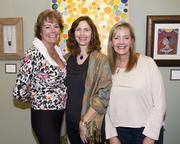 Consultant Anne Mahoney, California State University Sacramento director of corporate and foundation relations Suzette Riddle and University of California Davis MIND Institute community relations officer Terri Contenti pose at a Capital Public Radio art exhibition.