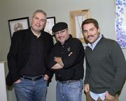 Capital Public Radio staff Joe Barr, Kent Teeters and James Morrison pose at a reception for an art exhibition.