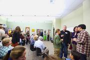 People come to look at an art exhibition at Capital Public Radio.
