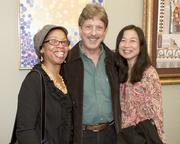 Capital Public Radio board chairwoman Donna Burke, California Community Colleges project mentor Paul Barth and Elk Grove Unified School District educator Teresa Cheung pose at an art exhibition.