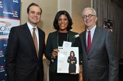 From left, Jon Witter, honoree Renee DeSilva of The Advisory Board Co. and Alex Orfinger.