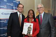 From left, Jon Witter, honoree Caryn Mathes, general manager of WAMU 88.5 and Alex Orfinger.