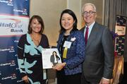 From left, Ridgewells Catering CEO Susan Lacz, honoree Song Pak of Revolution LLCand Alex Orfinger.