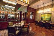 Bill Husted and Don Elliman met at Edge, the Four Seasons' elegant bar adjacent to the luxury hotel's main lobby.
