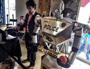 Irvin Cardenas, grad student at FIU, guides 'Hutch', a robot designed for disabled veterans and police.