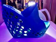 """A stylish plastic shoe that was """"printed"""" in a 3D printing machine at the Miami Mini Maker Faire."""