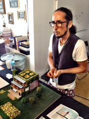 Nando Jaramillo explained a model for Colony1, an eco-friendly educational facility with site approval in Miami.