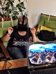 A visitor at the Maker Faire tests a virtual reality roller coaster from VR Labs at the LAB Miami.