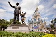 """""""Partners,"""" a statue of Walt Disney and Mickey Mouse, sits in front of Cinderalla Castle at Magic Kingdom, part of the Walt Disney World theme park and resort in Orlando."""