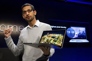 Sundar Pichai, senior vice president for Chrome at Google Inc., holds up a new Chromebook Pixel as he speaks during a launch event in San Francisco on Thursday. Google, owner of the worlds most popular search engine, debuted a touchscreen version of the Chromebook laptop, stepping up its challenge to Microsoft Corp. and Apple Inc. in hardware. 
