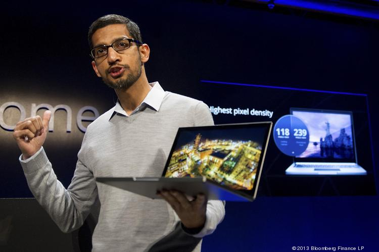 Sundar Pichai, senior vice president for Chrome at Google Inc., holds up a new Chromebook Pixel as he speaks during a launch event in San Francisco on Thursday. Google, owner of the world's most popular search engine, debuted a touchscreen version of the Chromebook laptop, stepping up its challenge to Microsoft Corp. and Apple Inc. in hardware.