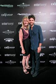 Amber Lounge owner Sonia Irvine and actor Adrian Grenier at the Amber Lounge during the U.S. Grand Prix in Austin.