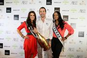 Nicholas Frankl, center, CEO of My Yacht Club Group with Miss Oklahoma, left, and Miss Texas at the Sunday night F1 party.