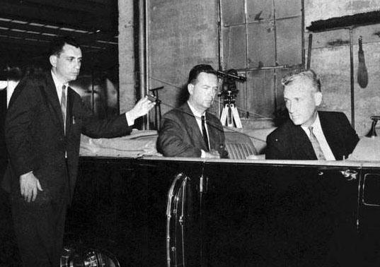 "Arlen Specter demonstrates the controversial ""single bullet theory"" to the Warren Commission."