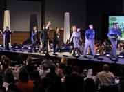 Classica Homes employees hit the runway to accept their award at the 2013 Best Places to Work event.