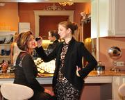 Fancy Schmancy Manager April Heller (left) and employee Kristen Swider at the make-up counter. The business has 14 employees.