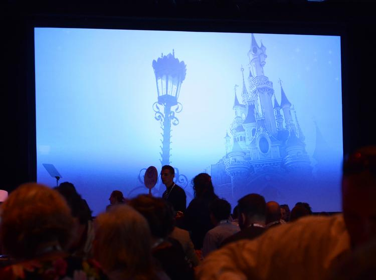 Video spots featuring Disney parks played as guests enjoyed lunch before George Kalogridis took the stage for his IAAPA lunch and learn event.