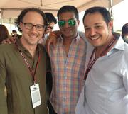 Jay Manickam, center, CFO of Austin's uShip Inc. in the company's suite during Sunday's F1 race at Circuit of The Americas, with Dean Jutilla, left, of uShip; and David Ramos, right, of Austin-based David Ramos Law.