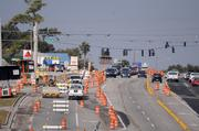 Hazard barricades line the stretch of SR 50 leading up to the U.S. 27 interchange construction site.