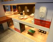 A WeMo switch allows homeowners to control lights in their houses using a smartphone.