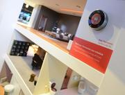 A miniature house demonstrates how a mobile device can control a Nest thermostat.