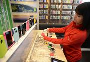 Jen Neve holds color swatches for customizable Otter Box phone cases.