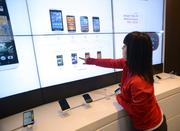Customers can compare devices on a giant touchscreen.