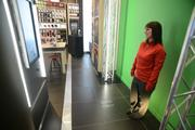 A green screen inside of the store will allow customers to have a picture  printed on a phone case within an hour.