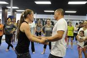 Egan Inoue demonstrates self-defense techniques with trainer Corrie Agon during a workshop at the new Egan's Fit Body Boot Camp training center in Pucks Alley in Honolulu. Proceeds from the workshop benefit the  Kapiolani Medical Center Women & Children.