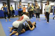 Egan Inoue demonstrates how to get out of a choke hold situation with trainer Corrie Agon during a workshop at the new Egan's Fit Body Boot Camp training center in Pucks Alley in Honolulu. Proceeds from the workshop benefit the  Kapiolani Medical Center Women & Children.