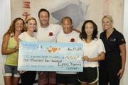 """From left, Lori McCarney, Kapiolani Health Foundation Board; Martha Smith, Kapiolani Medical Center; Alex O'Loughin of """"Hawaii Five-0""""; Egan Inoue of Egan's Fit Body Boot Camp training center; Kimberly Dey, Kapiolani Health Foundation Board; and Amanda Price, Kapiolani Health Foundation associate director, pose with a check for $10,500 presented to Kapiolan Medical Center for Women & Children."""
