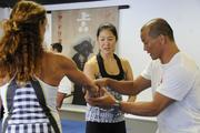 Egan Inoue, right, working with Lori McCarney, left, and Lilian Kanai during a workshop at the new Egan's Fit Body Boot Camp training center in Pucks Alley in Honolulu. Proceeds from the workshop benefit the  Kapiolani Medical Center Women & Children.