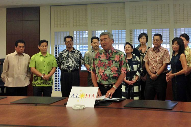 Hawaii Bankers Association Executive Director Ed Pei, flanked by members of the Filipino Community Center and the Consuelo Foundation as well as the association's member banks,  said Hawaii's 11 banks will accept donations for victims of Typhoon Haiyan in the Philippines.