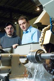 December 2004: VStream Manufacturing Inc.purchases Feuz Manufacturing Inc.'s Rotterdam plant, as well as its property and equipment.  Pictured: VStream Manufacturing COO David Dussault, right, with employee Michael Vito Pantuosco.