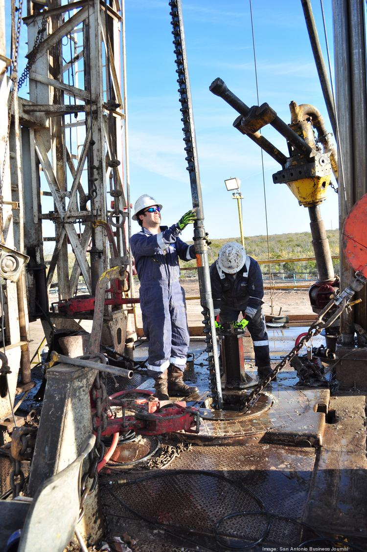 Baker Hughes Inc. employees work on a drilling site in the Eagle Ford Shale.