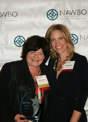 Anchor Paper Co. CEO Linda Hartinger (left), winner of the Woman Pioneer Award, with NAWBO-MN President Heather Manley.
