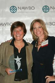 Finnegans and Finnegans Community Fund CEO and Founder Jacquie Berglund (left), winner of the Established Woman Business Owner of the Year (more than $1 million in revenue), with NAWBO-MN President Heather Manley.