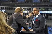 ESPN announcer and former NFL linebacker Ray Lewis gets a touch up before going on the air.