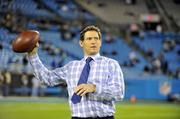 ESPN announcer and Hall of Fame NFL quarterback Steve Young passes the ball around during the pre-game.