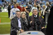 Carolina Panthers owner Jerry Richardson (right) rides across the field before the team's win against the New England Patriots.