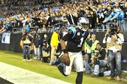 Quarterback Cam Newton is all smiles as he shows off for fans at Bank of America Stadium.