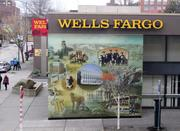 The Wells Fargo mural depicts a collage of historical images associated with the university, including 1920s Huskies football player Ham Green and Charles Lindbergh's 1927 visit to Seattle.