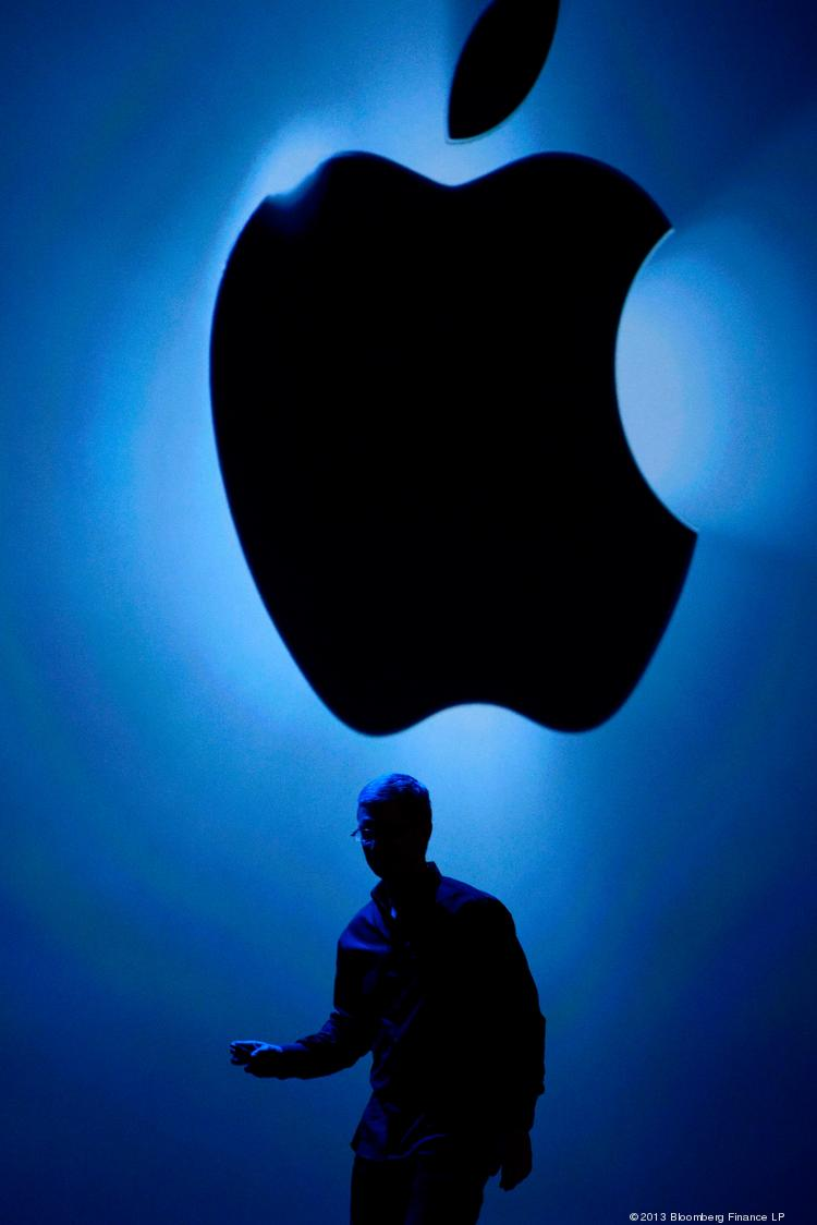 Tim Cook, chief executive officer at Apple Inc., exits the stage after speaking at an event in San Francisco earlier this year. Apple has made another acquisition, buying Topsy Labs, a San Francisco startup that will give Apple access to data on Twitter trends.