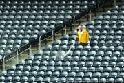 Lower grandstand seats at PNC Park are cleaned.