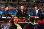 ESPN announcers Steve Young, Trent Dilfer and Ray Lewis on the set before game time.