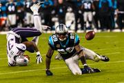 Carolina Panthers wide receiver Steve Smith and New England Patriots defensive back Aqib Talib both tumble after going for the ball.